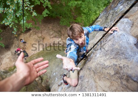 Stockfoto: Helping Hand Hiking Get Help Friend From Man In A Dangerous Situ