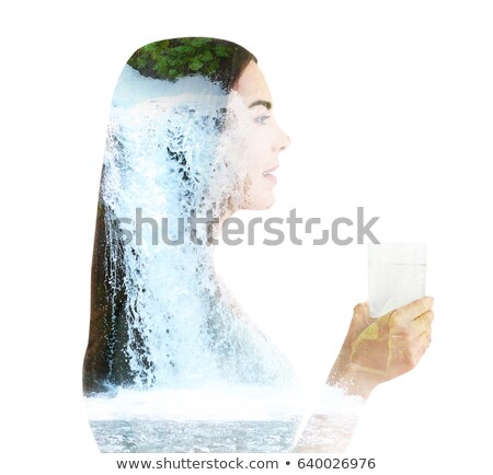 Young woman drinks water on a waterfall background Stock photo © galitskaya