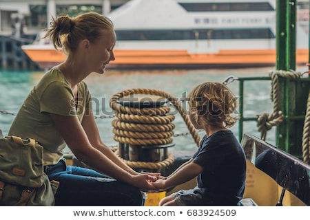 Mom and son go by ferry in Hong Kong Stock photo © galitskaya
