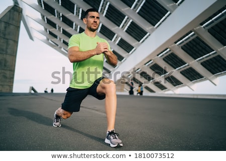 Full-length focused, motivated handsome sportsman in activewear, shorts, t-short and sports leggings Stock photo © benzoix