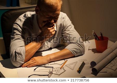 Cansado entediado homem trabalhando tarde noite Foto stock © dolgachov