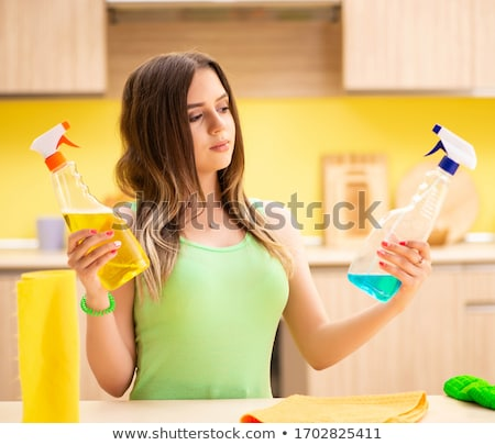Young beatifull woman polishing table in the kitchen  Stock photo © Elnur