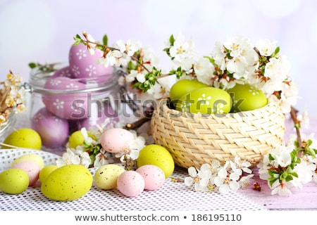 Easter composition. Easter eggs in a glass box on a white and gray background. Greeting card for cop Stock photo © user_15523892