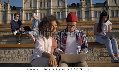 человека женщину студент сидят трава университета Сток-фото © Kzenon