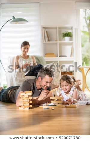father and daughter playing a game at home stock photo © photography33