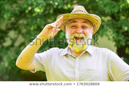 Man wearing a straw hat Stock photo © photography33