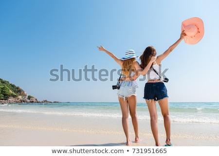 hátulnézet · két · nő · tengerpart · fürdőruha · áll · néz - stock fotó © photography33