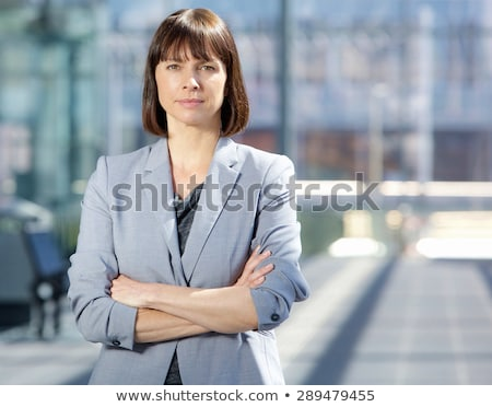 ernstig · zakenvrouw · permanente · rechtdoor · camera · business - stockfoto © Rebirth3d
