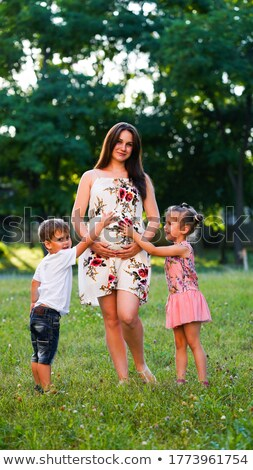 pregnant girl on meadow 3 Stock photo © Paha_L