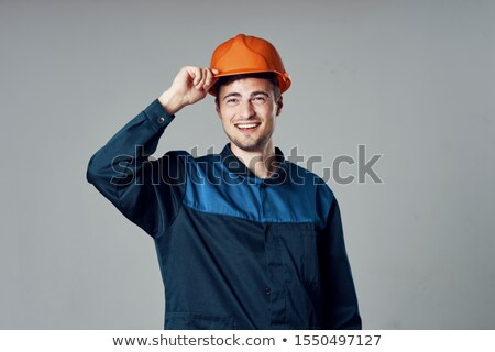A construction worker posing with his tools Stock photo © photography33