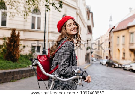 fashionable young brunette posing outdoors stock photo © lithian