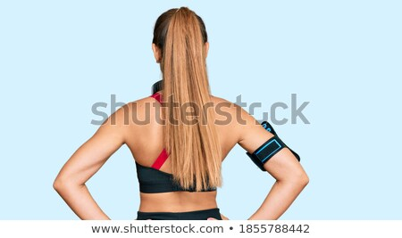 attractive girl wearing headphones looking back stock photo © stockyimages