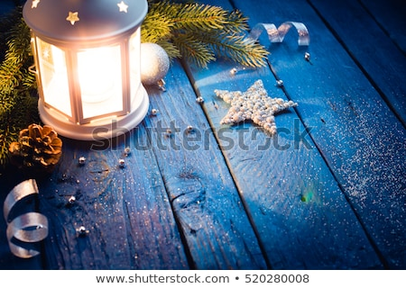 lantern in a night with stars and a christmas ball stock photo © rob_stark