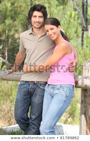 Couple stood by wooden fence Stock photo © photography33
