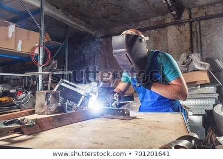 Strong young man with a gas torch Stock photo © acidgrey
