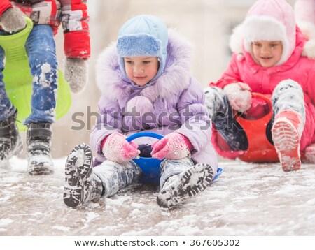 çocuklar slayt aşağı buz gibi tepe kış Stok fotoğraf © krugloff
