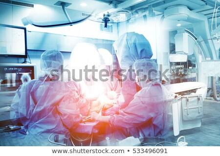 Grave médico realizar cirugía primer plano hombre Foto stock © wavebreak_media