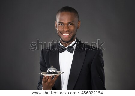 Stock photo: Waiter holding hand out to front in presentation