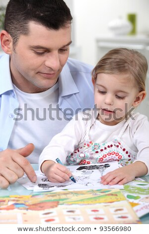 little girl colouring under dad's watchful eye Stock photo © photography33
