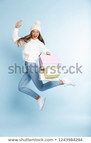 Winter woman posing at white background with shopping bag and op Stock photo © HASLOO