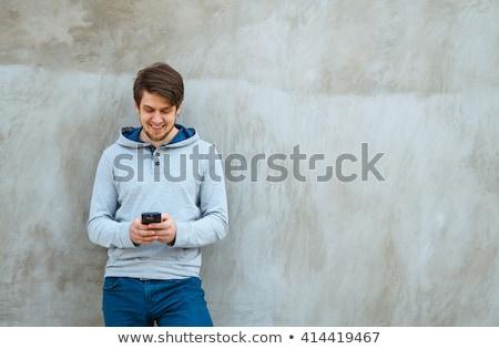 Bonito atraente moço em pé parque ao ar livre Foto stock © Len44ik