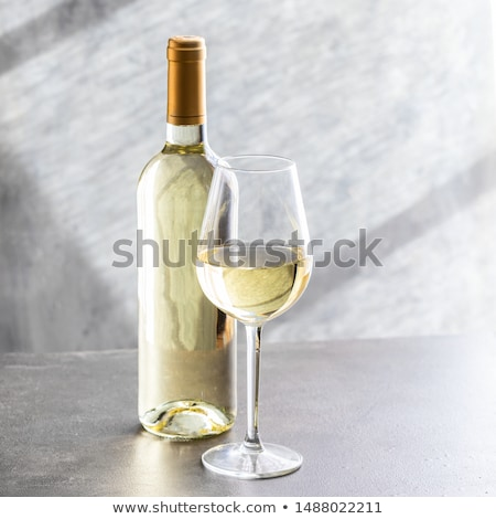 glass and bottle of white wine stock photo © vwalakte