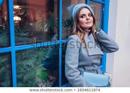 sitting young woman wearing extravagant clothes Stock photo © phbcz