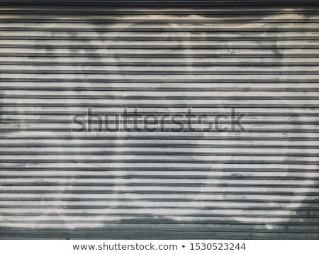 old grungy industrial garage door with graffitis stock photo © aetb