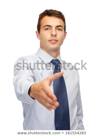 friendly buisnessman with hand ready for handshake stock photo © dolgachov