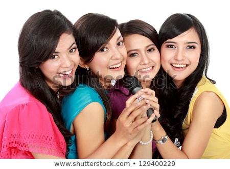 Four beautiful girls singing karaoke Stock photo © AndreyPopov