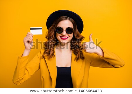 young woman with her thumb up stock photo © stockyimages