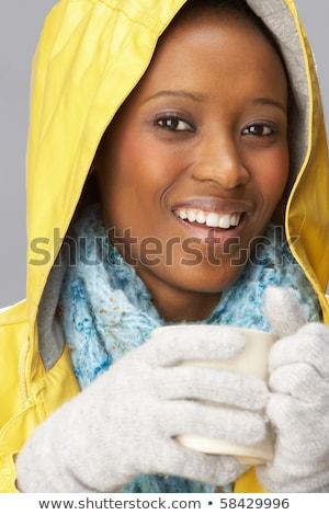 Jonge vrouw drinken warme drank Geel vrouw Stockfoto © monkey_business