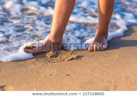 Gyermek sétál mezítláb víz nő naplemente Stock fotó © Len44ik