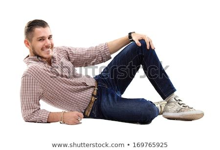 happy young casual man laying down stock photo © feedough