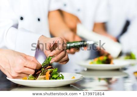 Gyakornok szakács dolgozik étterem konyha étel Stock fotó © HighwayStarz