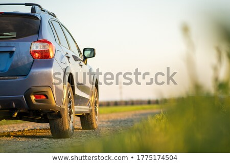 Driving at a gravel road Stock photo © olandsfokus
