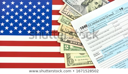 tax form and money stock photo © klinker