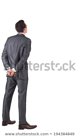 Businessman standing with hands behind back Stock photo © wavebreak_media