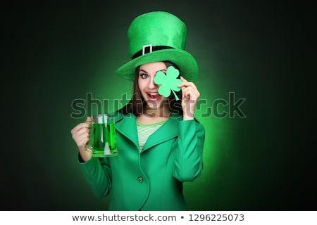 Woman wearing saint patrick hat Stock photo © Elnur