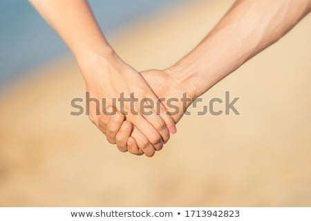 young couple walking on the beach stock photo © michaklootwijk