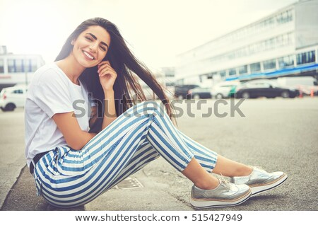 attractive young woman lots of sunshine stock photo © konradbak