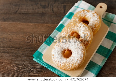 Sweet sugary donuts on rustic table Stock photo © stevanovicigor