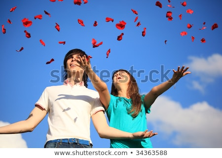 young pair scatters petals of roses against sky Stock photo © Paha_L