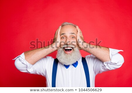 head of a smiling old businessman stock photo © bluering