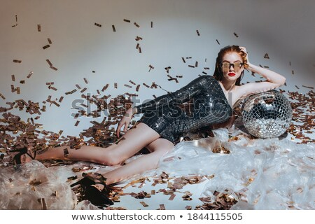 Portrait of a young redhead woman with styled glasses lying down Stock photo © Massonforstock