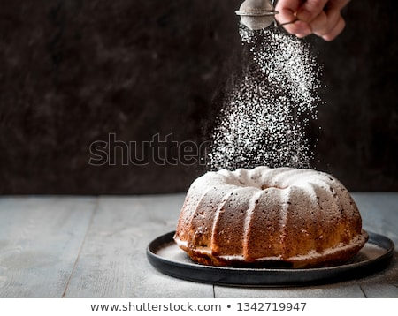 Muffins Powdering with Sugar Powder  Stock photo © dariazu