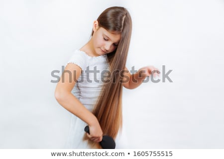 Portrait of cute lovely little girl with long hair Stock photo © deandrobot