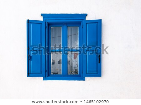 Blue window shutters on the white facade Stock photo © smuki