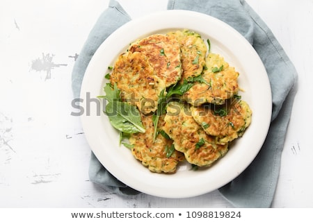 Cukkini zöldség palacsinták étel háttér asztal Stock fotó © yelenayemchuk