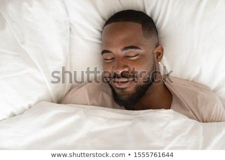 Człowiek bed snem facet koc Zdjęcia stock © MaryValery